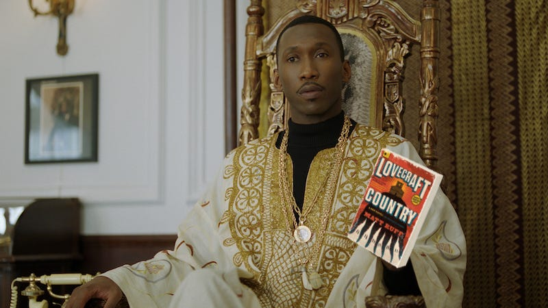 Mahershala Ali as Don Shirley, with the cover of Lovecraft Country.