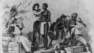 The inspection and sale of a Negro. This reproduction of a wood engraving was originally published in Captain Canot, Twenty Years of an African Slaver by Brantz Mayer. It depicts an African man being inspected by a white man while another white man talks with slave traders.Public Domain