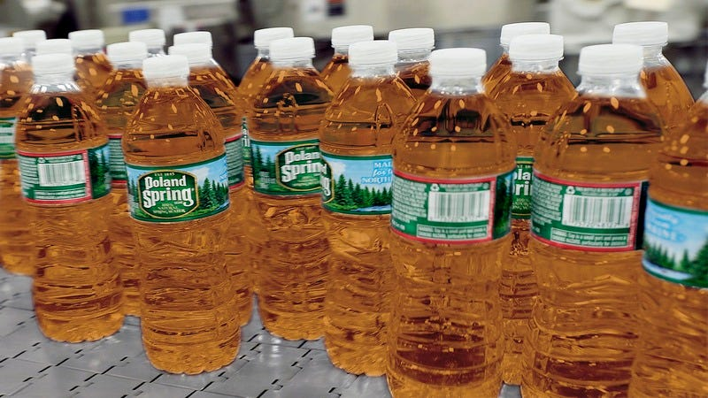 Poland Spring plastic bottles filled with apple juice.