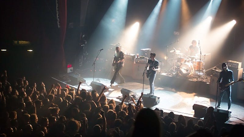 Illustration for article titled Eagles Of Death Metal Returns to Paris to Perform, Joins U2 On Stage
