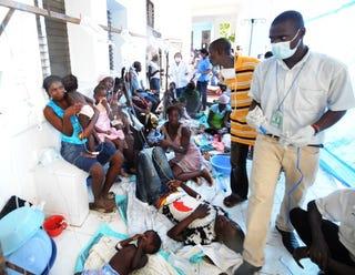Haitian cholera victims await aid.