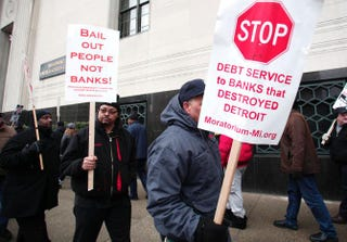 Protesters outside the U.S. Courthouse while federal bankruptcy Judge Steven Rhodes ruled on Detroit's Chapter 9 bankruptcy eligibility on Dec. 3, 2013, in DetroitBill Pugliano/Getty Images