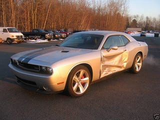 "Illustration for article titled For Sale: One ""Slightly Damaged"" Challenger SRT8 With 29 Miles On Odometer"