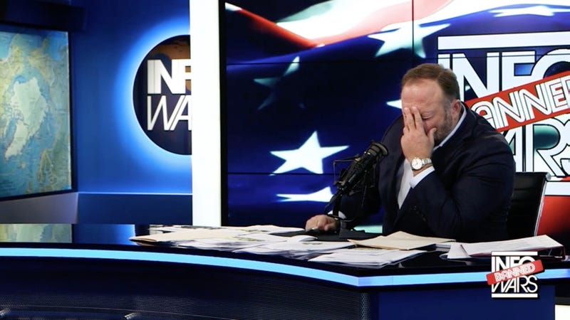 Alex Jones holds his head in his hand on August 14, 2018