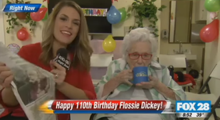 Reporter with Flossie Dickey        YouTube Screenshot