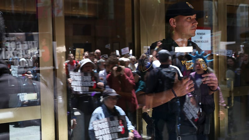 A uniformed Department of Homeland Security officer, identified by Getty as an Immigration and Customs Enforcement agent, monitors a protest in San Francisco on June 19th, 2018.