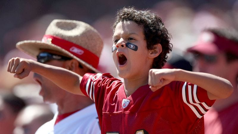Illustration for article titled Jubilant 7-Year-Old Fan Of Arizona Cardinals Doesn't Even See It Coming