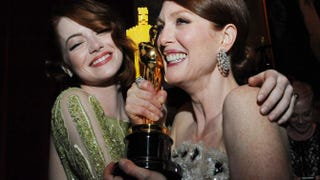 Nominee for best supporting actress Emma Stone embraces best actress winner Julianne Moore at the Governor's Ball after the 87th Oscars Feb. 22, 2015, in Hollywood, Calif.VALERIE MACON/AFP/Getty Images