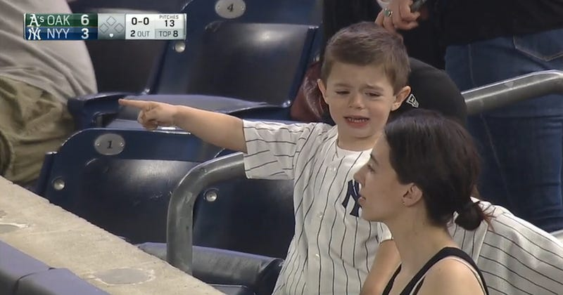 Illustration for article titled Sad Tiny Yankees Fan Doesn't Want Anyone Cheering Chris Coghlan's Home Run