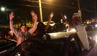 Demonstrators raise their hands Aug. 15, 2014, as they protest the shooting death of Michael Brown in Ferguson, Mo. Brown was killed in broad daylight on Aug. 9, 2014, with witnesses and law enforcement providing conflicting accounts of how the 18-year-old lost his life.Joshua LOTT/AFP/Getty Images