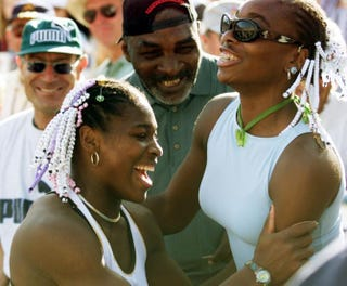 Serena Williams celebrates her Evert Cup final victory with her sister Venus and her father, Richard, March 13, 1999, in Indian Wells, Calif.MIKE NELSON/AFP/Getty Images