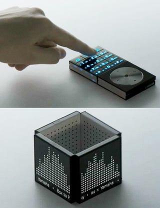 Illustration for article titled KDDI's Concept Cellphone is Half Transformer, Half Musical Box