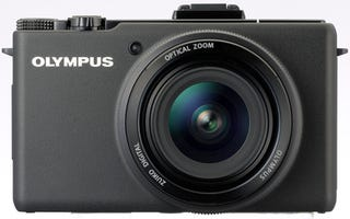 Illustration for article titled Olympus' Camera Lacks Interchangeable Lenses, But Will Be New Compact Flagship