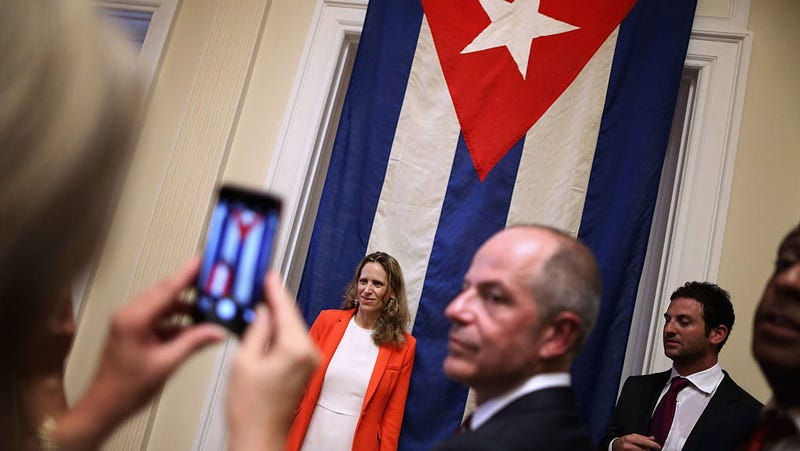 People pose for photographs at reopening of Cuban embassy. Photo: Getty