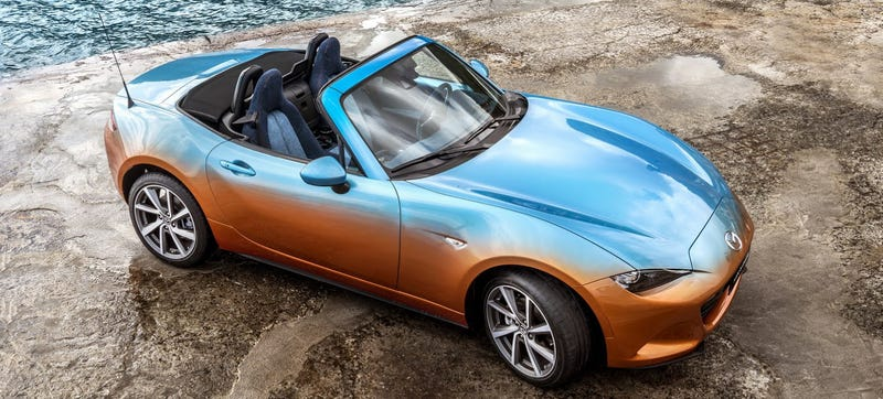 Illustration for article titled Placate Your Fears Of Global Economic Collapse With This Two-Tone Miata With A Denim Interior