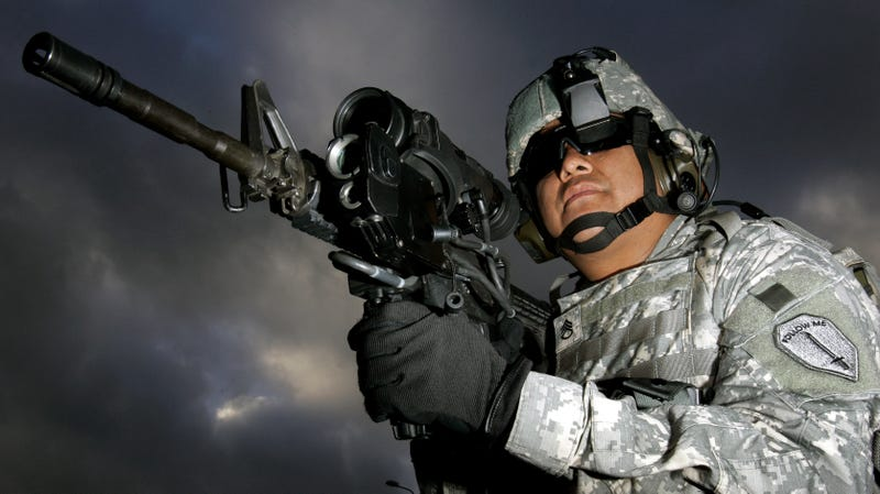 U.S. Army Staff Sergeant Ruben Romero demonstrates then-new attachments for the M4 rifle in 2006.