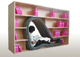 Illustration for article titled Cave Bookcase Saves Space For Those Who Don't Need It