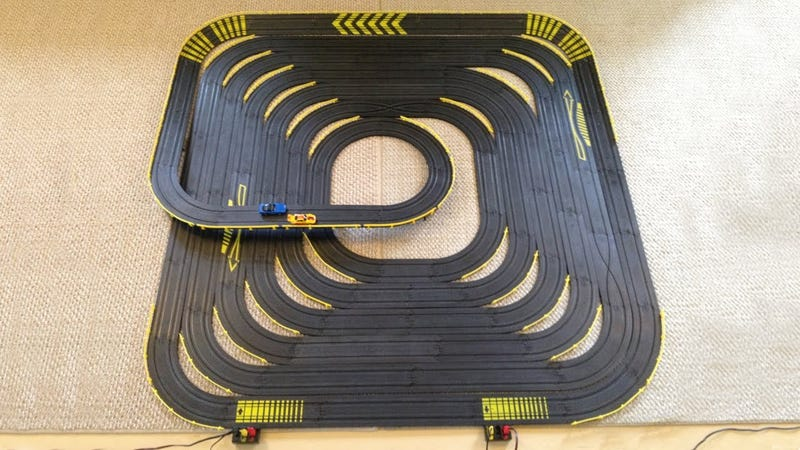 Illustration for article titled I need some slot car track sections.
