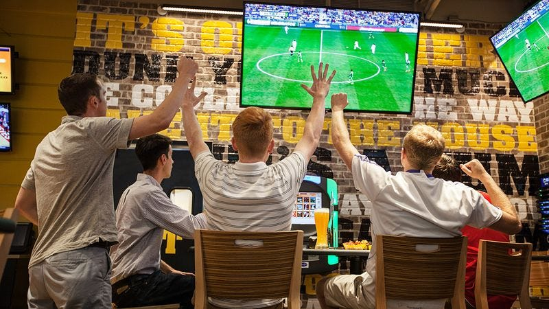 Illustration for article titled Man Invites Friends To Bar To Watch Game, Interact Fleetingly During Commercial Breaks