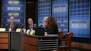 Anthony Fauci (second from left), director of the National Institute of Allergy and Infectious Diseases, speaks as (from left to right) Jesse Goodman of the Georgetown University Medical Center and WTOP news anchors Bruce Alan and Debra Feinstein listen during a town hall meeting on Ebola Oct. 20, 2014, at the Newseum in Washington, D.C.Alex Wong/Getty Images
