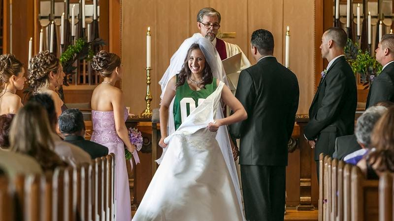 A bride using Vera Wang's new tear-away wedding dress.