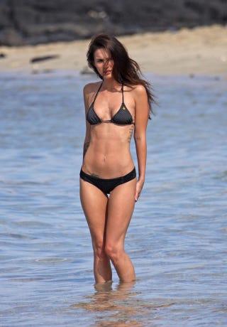 Illustration for article titled Megan Fox's Teeny-Weeny Halfway Polka Dot Bikini