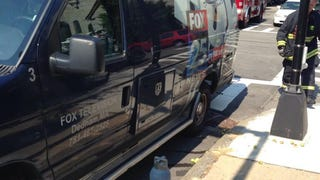 FOX news van crew blocks fire hydrant in front of Boston church fire