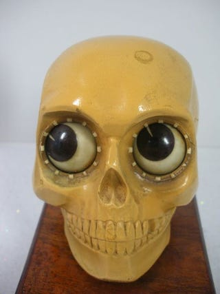 Creepily Cute Skull-Shaped Clock Rolls Its Eyes To Tell Time