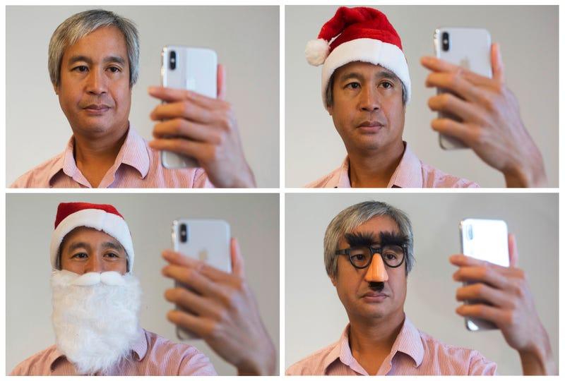 AP reporter Nick Jesdanun attempts to fool Face ID on the iPhone X. (Photo: AP)