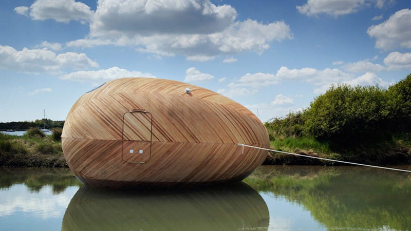 Illustration for article titled Uh, Why Is an Artist Living Inside a Floating Wooden Egg For a Year?