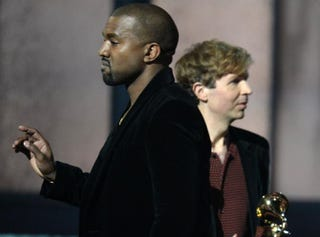 Beck reacts as Kanye West (left) appears onstage during the 57th annual Grammy Awards in Los Angeles Feb. 8, 2015.Robyn Beck/AFP/Getty Images