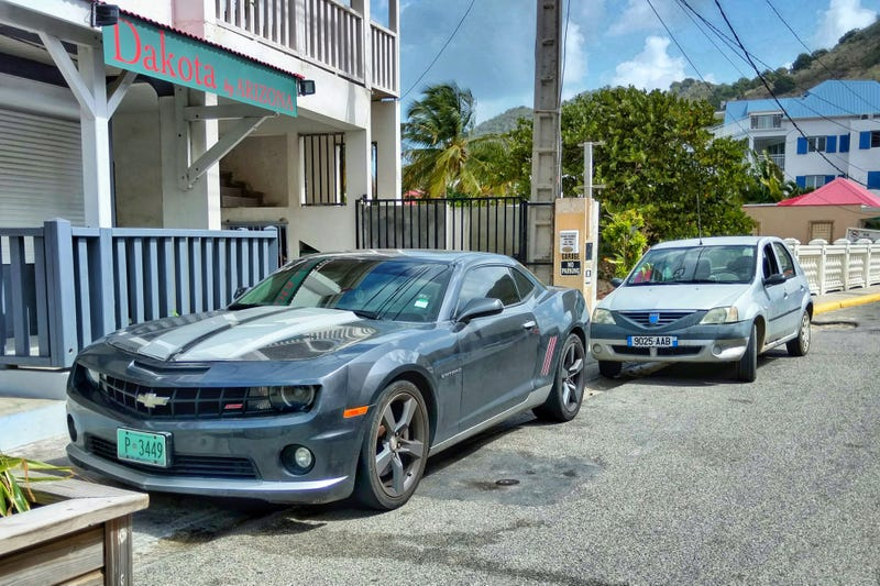 Illustration for article titled Saint Martin might be the only place in the world you can see a Camaro and a Dacia Logan together