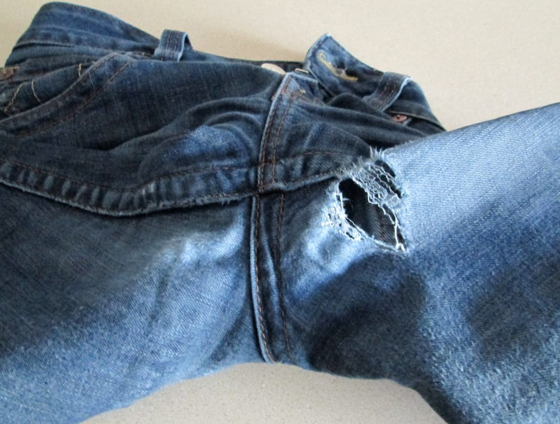 Illustration for article titled The sad story of my favourite pair of jeans, as told in images...