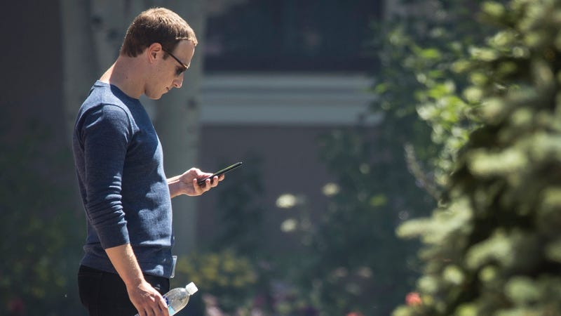 Mark Zuckerberg checks his phone during the annual Allen & Company Sun Valley Conference on July 13, 2018 in Sun Valley, Idaho.