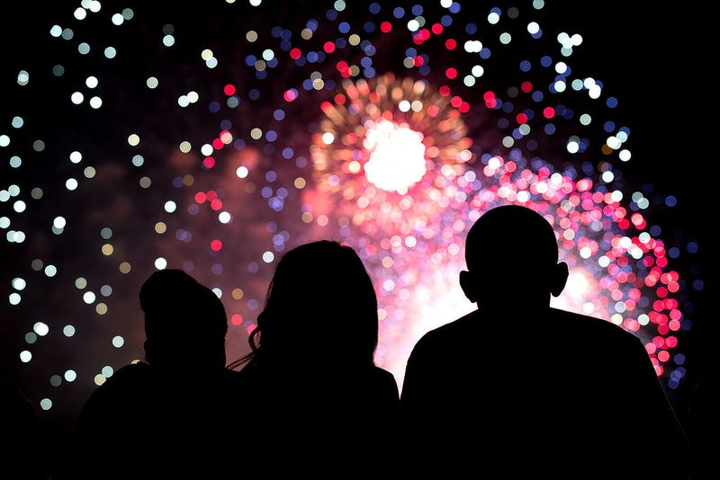 First lady Michelle Obama, Malia Obama and President Barack Obama watch the Fourth of July fireworks from the roof of the White House on July 4, 2014.Official White House Photo by Pete Souza