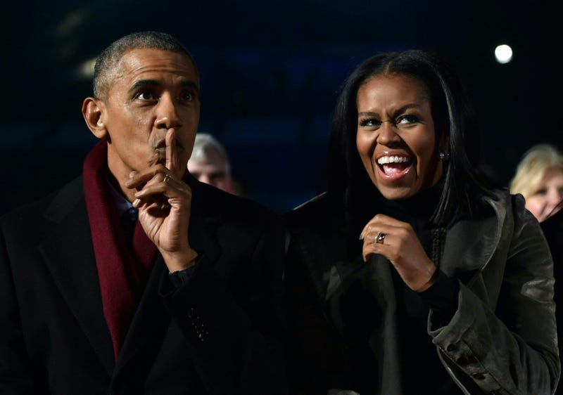 President Barack Obama and first lady Michelle Obama react during the National Christmas Tree Lighting on the Ellipse of the National Mall in Washington, D.C., on Dec. 1, 2016. NICHOLAS KAMM/AFP/Getty Images