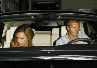 Illustration for article titled Posh Postures While Becks Takes The Wheel