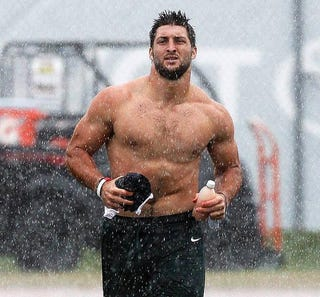 """Illustration for article titled Tim Tebow """"Didn't Really Think Y'all Would Be Filming"""" His Shirtless Run Through The Rain"""