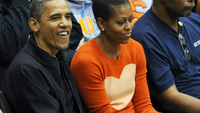Then-President Barack Obama and first lady Michelle Obama watch a basketball game in Towson, Md., on Nov. 26, 2011.