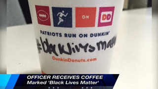 """A police officer claims that not only were the employees of a Rhode Island Dunkin' Donuts rude to him when he ordered a coffee Oct. 2, 2015, but they also wrote """"black lives matter"""" on the side of his cup.ABC 6 screenshot"""