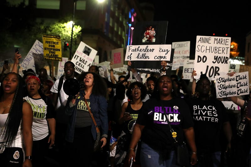 Black Lives Matter protesters march through the streets of Sacramento during a demonstration on March 30, 2018 in Sacramento, California.