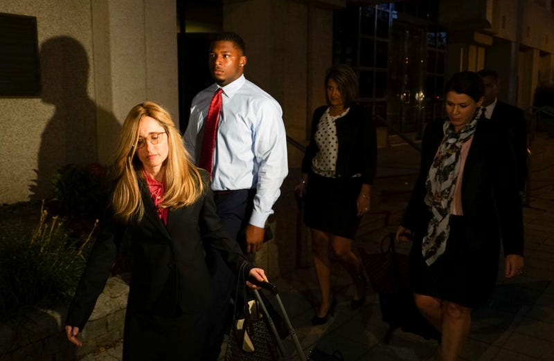 Ma'lik Richmond (center) of Steubenville, Ohio, walks out of a U.S. District Court with his attorney, Susan Stone (left), in Youngstown, Ohio, on Sept. 14, 2017. (Dake Kang/AP Images)