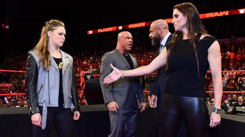 Ronda Rousey, Kurt Angle, Triple H, and Stephanie McMahon.