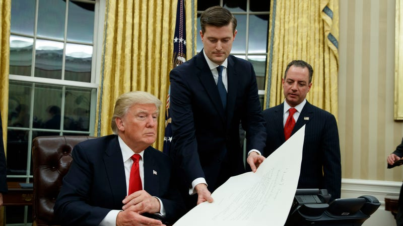 Accused domestic abuser Rob Porter (middle) with accused sexual harasser. Image via the AP.
