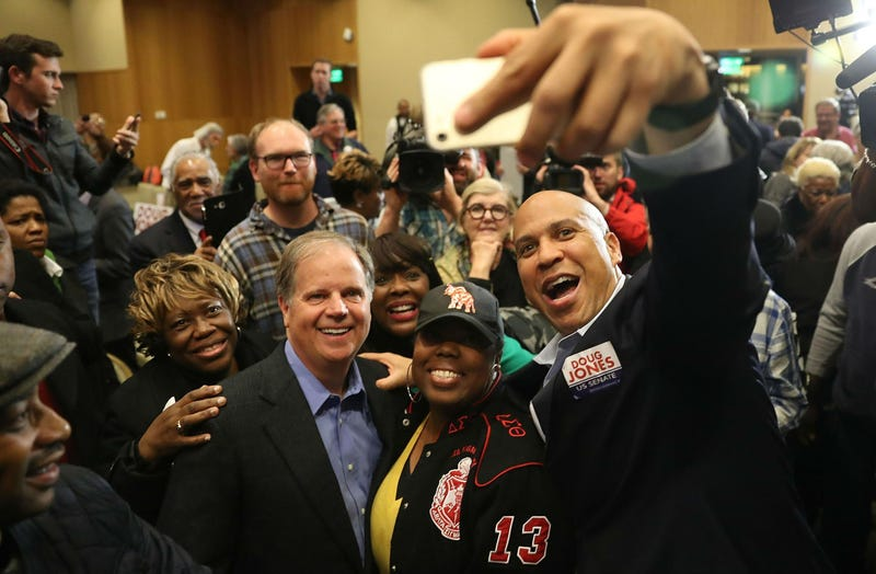 Democratic senatorial candidate Doug Jones (front, second from left) takes a group picture with Sen. Cory Booker (right) and Rep. Terri Sewell (third from right) and supporters during a campaign event at Alabama State University at the John Garrick Hardy University Student Center on Dec. 9, 2017, in Montgomery, Ala. (Joe Raedle/Getty Images)