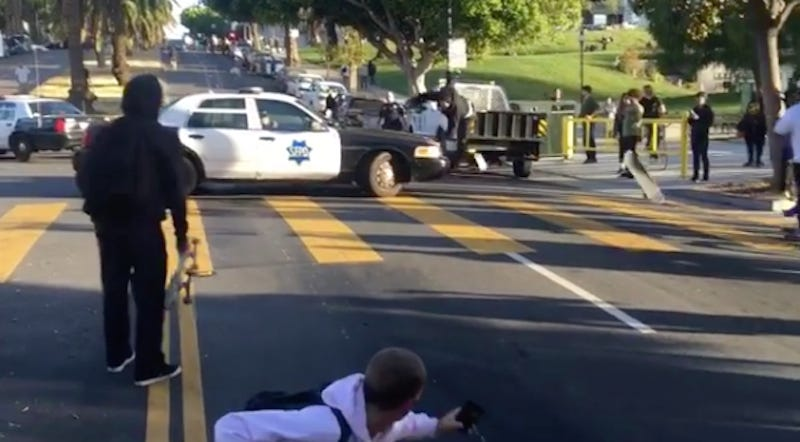 Policeman Guides Downhill Skateboarder Right Into The Hood Of A Cop Car