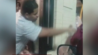 A Detroit McDonald's employee has been fired after video of him tossing water on a homeless man caused outrage.ABC 7 screenshot