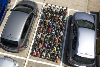 Illustration for article titled How Many Folding Bikes Does It Take To Fill a Parking Space?