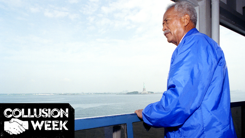 New York City Mayor David Dinkins gazes over New York Harbor from the Staten Island Ferry as it passes the Statue of Liberty in 1992 in New York.