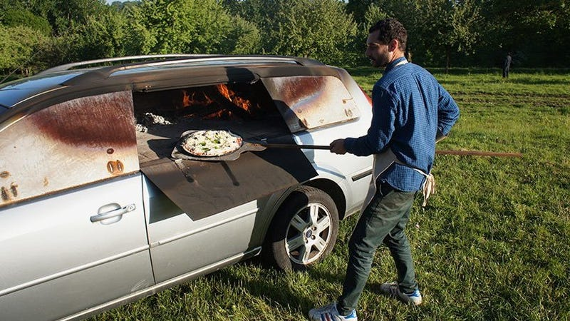 Illustration for article titled French Artist Benedetto Bufalino Is Turning Old Cars Into Pizza Ovens